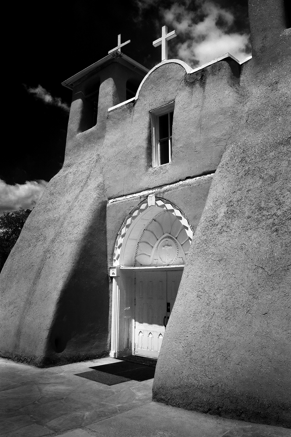 John captured this image of San Francisco de Asis Mission Church near Taos, New Mexico. The adobe church was built by the Franciscan Fathers and completed in 1815. Georgia O'Keefe described it as one of the most beautiful buildings left in the US by the early Spaniards.