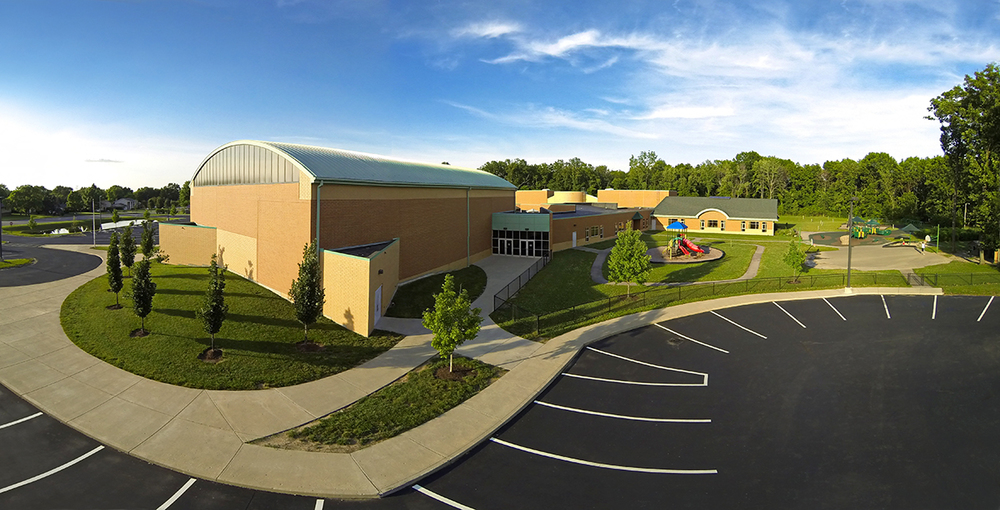 This unique perspective of John's is an aerial panorama. It was made from 3 photos shot with a quadcopter hovering at about 25 feet at Primary Village South School in Centerville. The images were then stitched together to create this wide angle view.