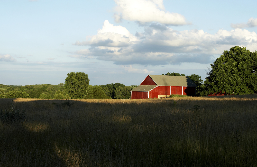 Steve shot this image while on a bike ride as the sun began to set just outside of Bellbrook, Ohio. The contrast of the long shadows and the bright red paint of the barn made it an image worth stopping for.