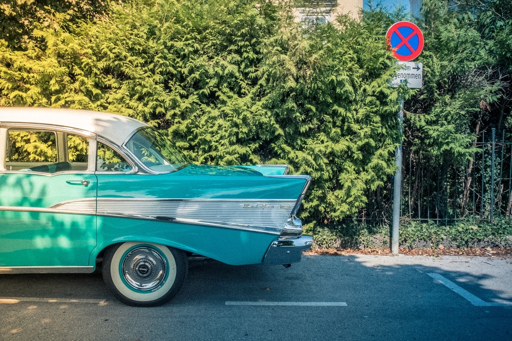 While heading back to the train station in Salzburg, Chris stumbled upon this Chevy Bel Air. In his attempt to show the contrast of Europe and the iconic 1950's US automobile, he spotted the very European street sign and composed accordingly.