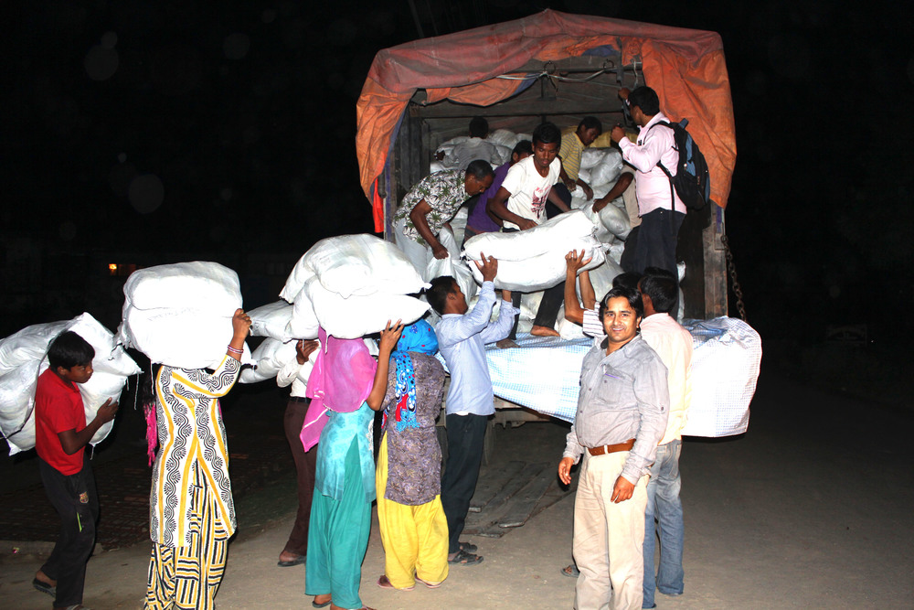 Church members toiled late into the night, purchasing goods at the India border market and loading the truck