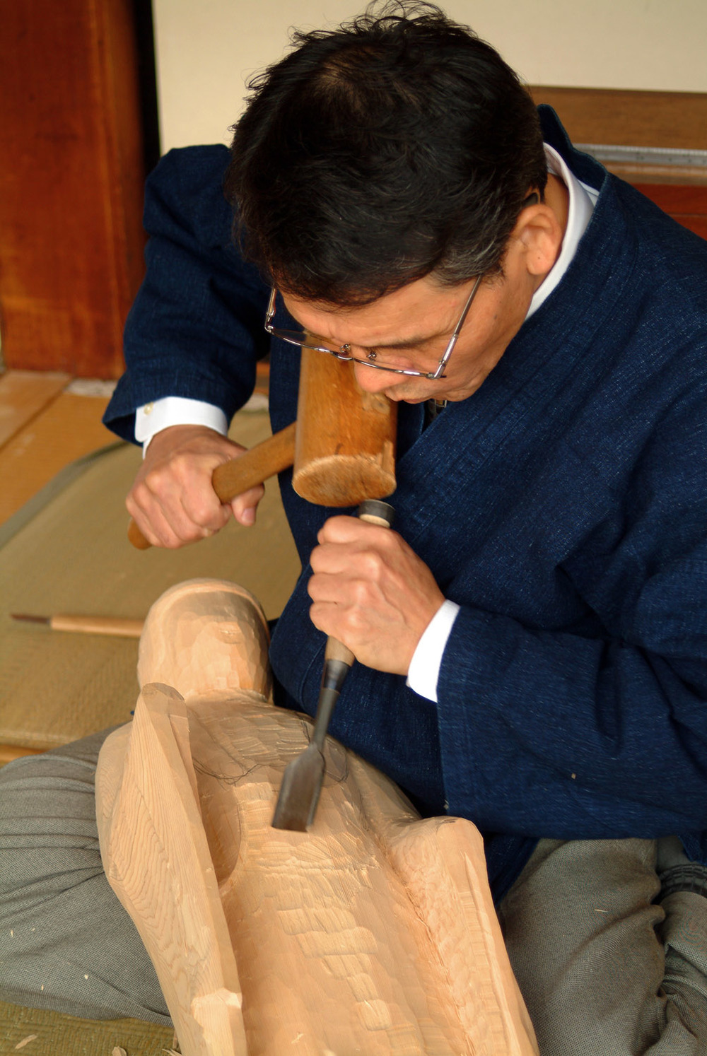 Sculptor carving Buddha figure