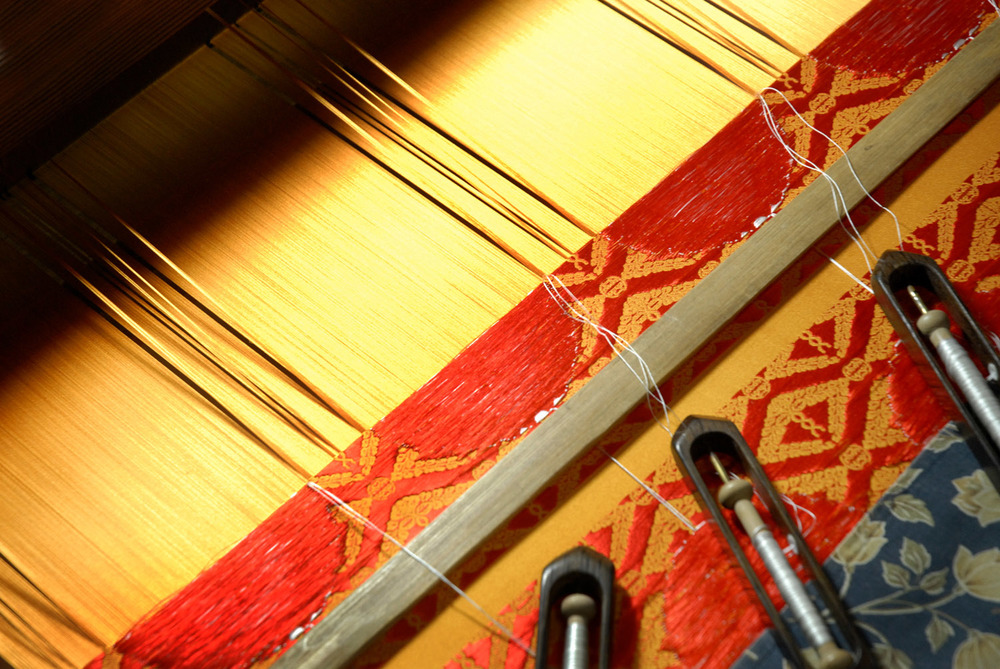 Weaving silk on a loom in Nishijin