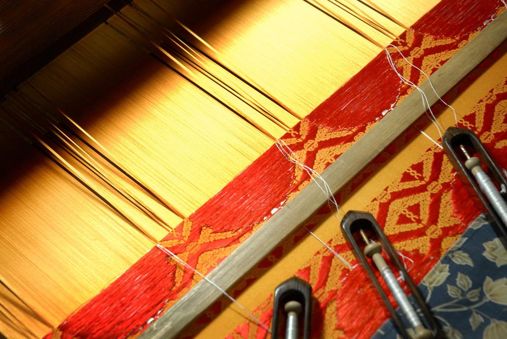 Weaving silk on a loom in Nishijin