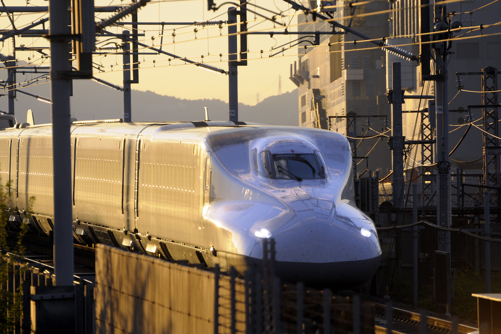 Shinkansen bullet train at sunset