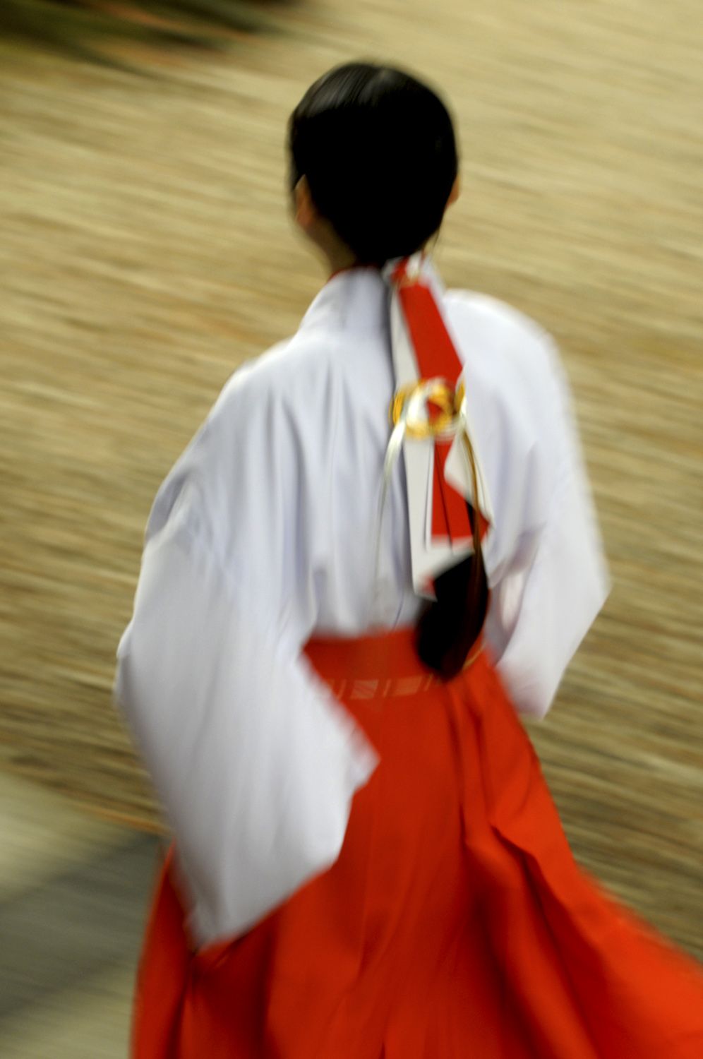 Shrine maiden at the Meiji Shrine Tokyo