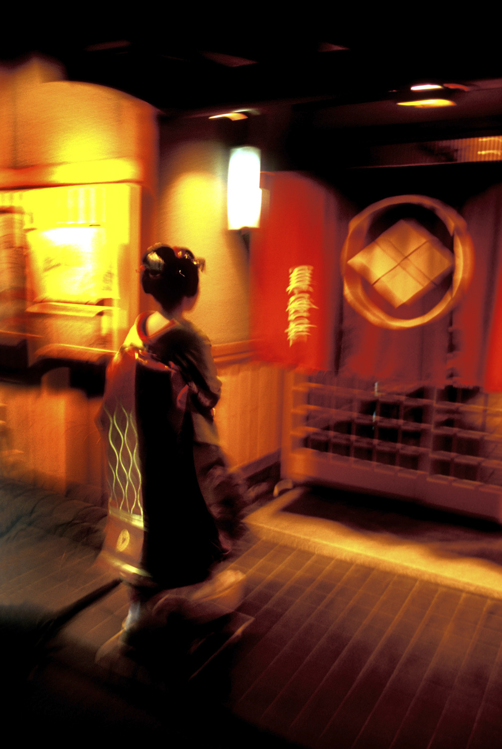 A maiko going into a Gion restaurant