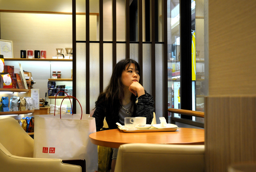 Wistful woman in a coffee shop
