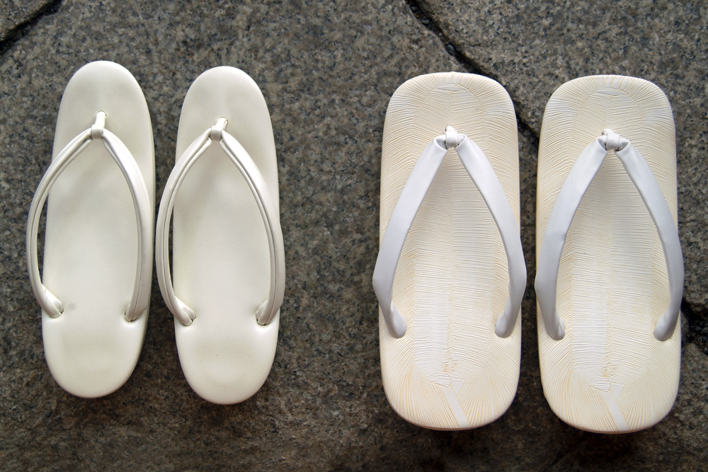 A bridal couple's wedding shoes