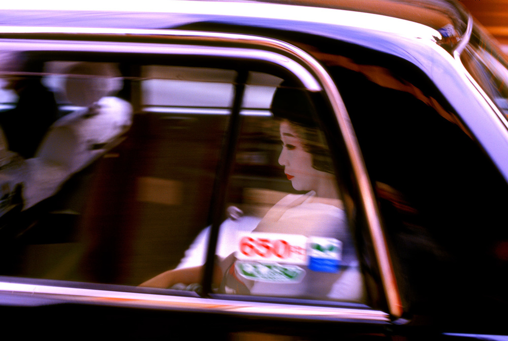 Geisha in a taxi in Gion