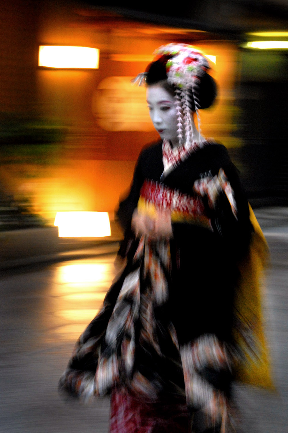 A Maiko hurrying to her appointment
