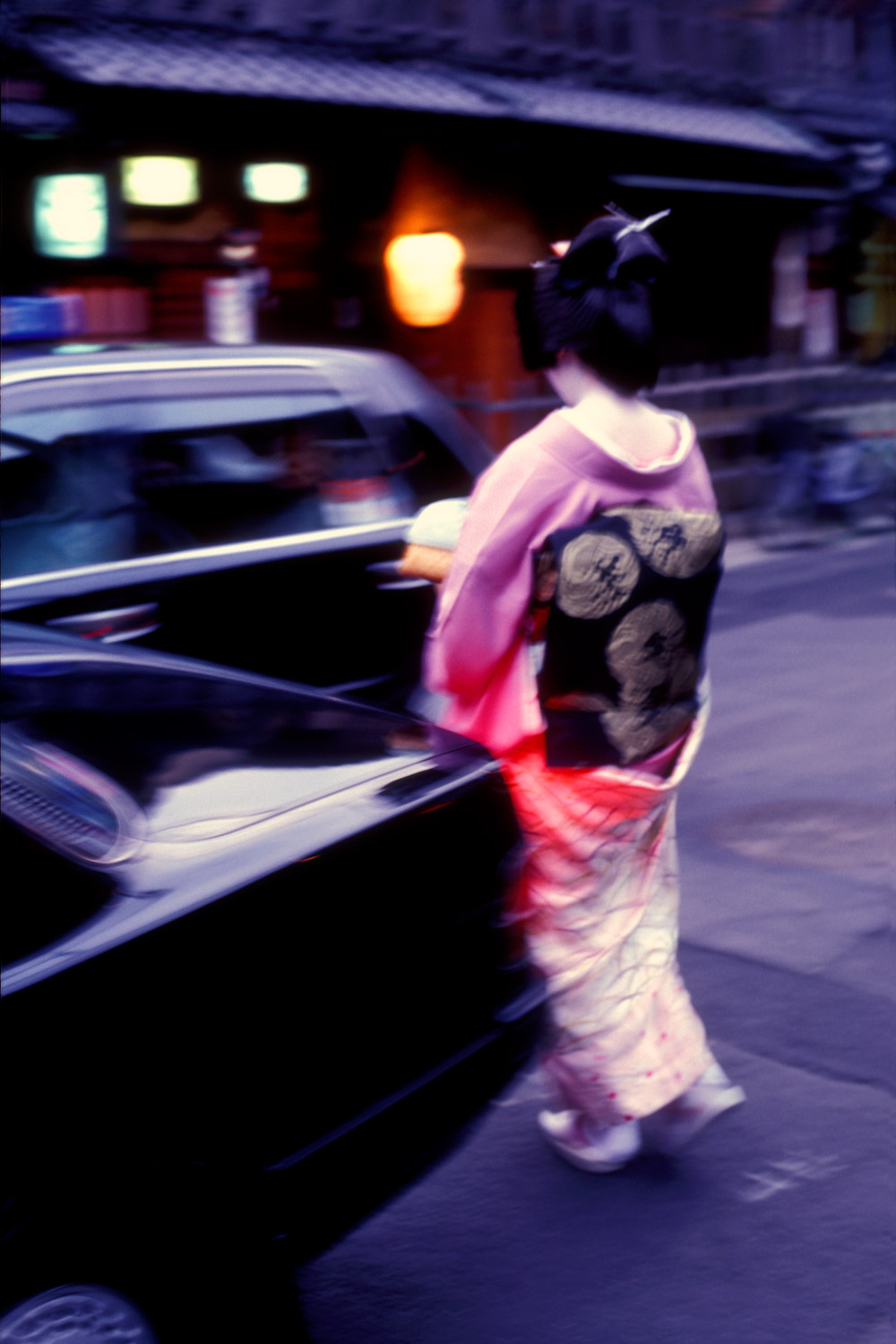 Geisha and a taxi in Gion