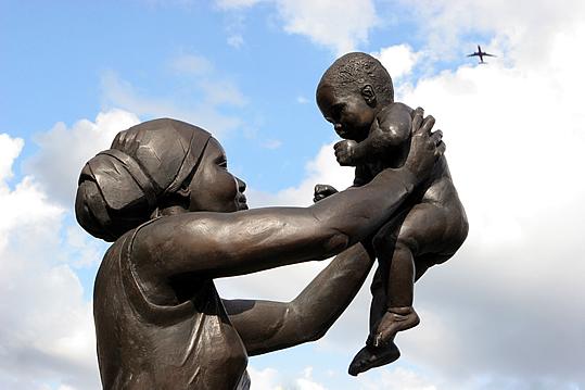 Bronze Woman statue by Cécile Nobrega. (Stockwell Memorial Gardens, London)