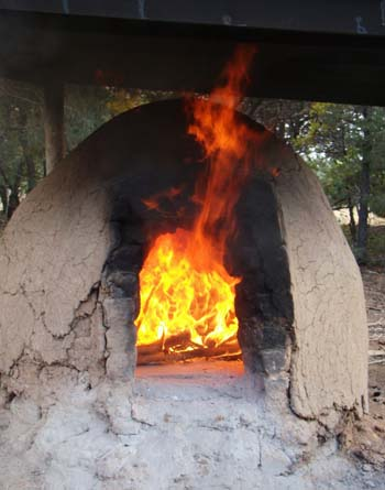 The wood-fired clay horno makes delicious pizza for sixty people