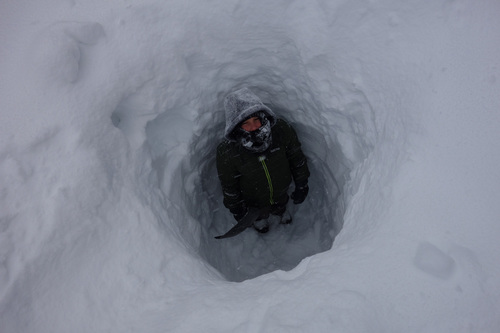 Syd Slater studies the snowpack depth