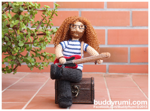 Amigurumi crochet bass guitar player