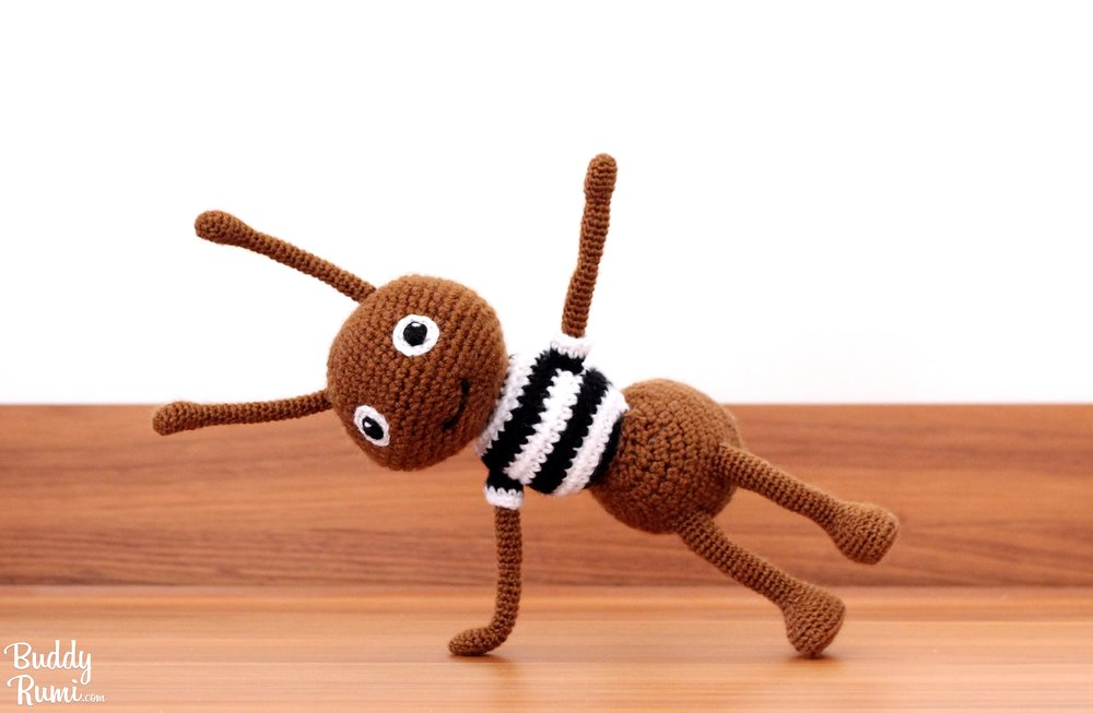 Amigurumi ant doing yoga