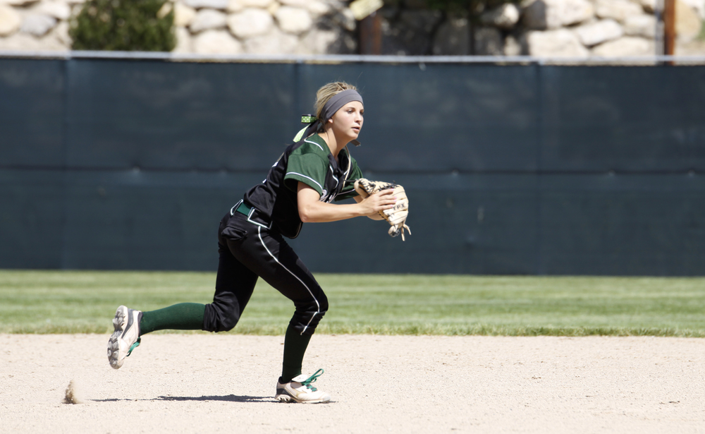 Payson shortstop, McKinley Ferrin races to second base to make the out.