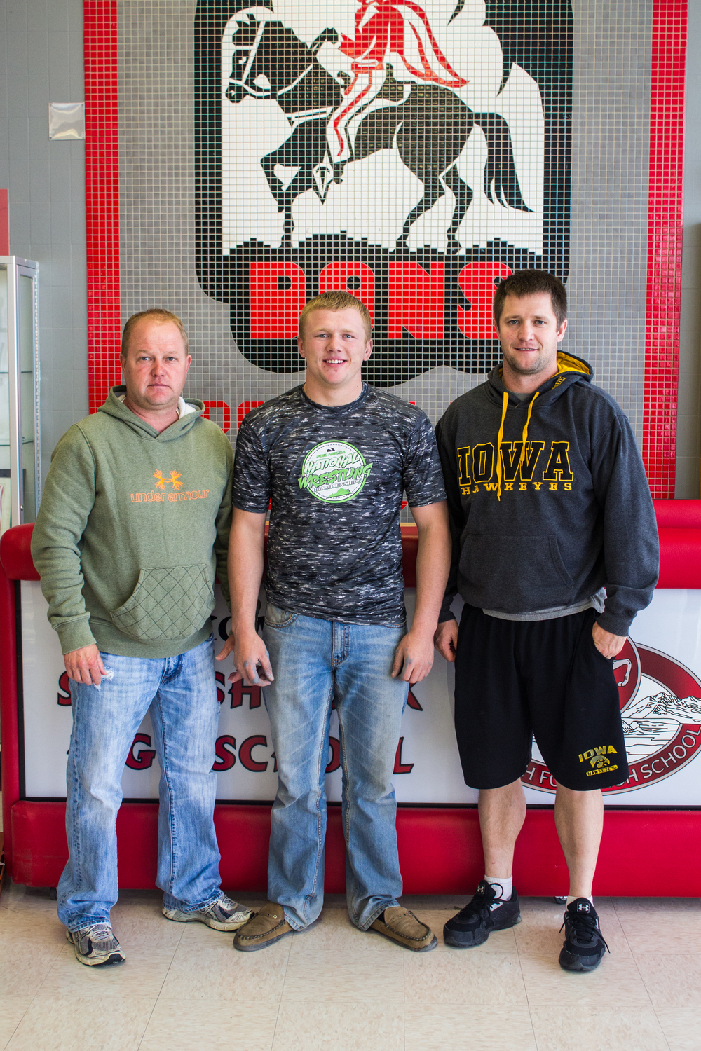 Pictured: Heber Shepherd (center) with Travis Shepherd (left) and Kip Spencer (right), two of his coaches.  Photo courtesy Spanish Fork High School