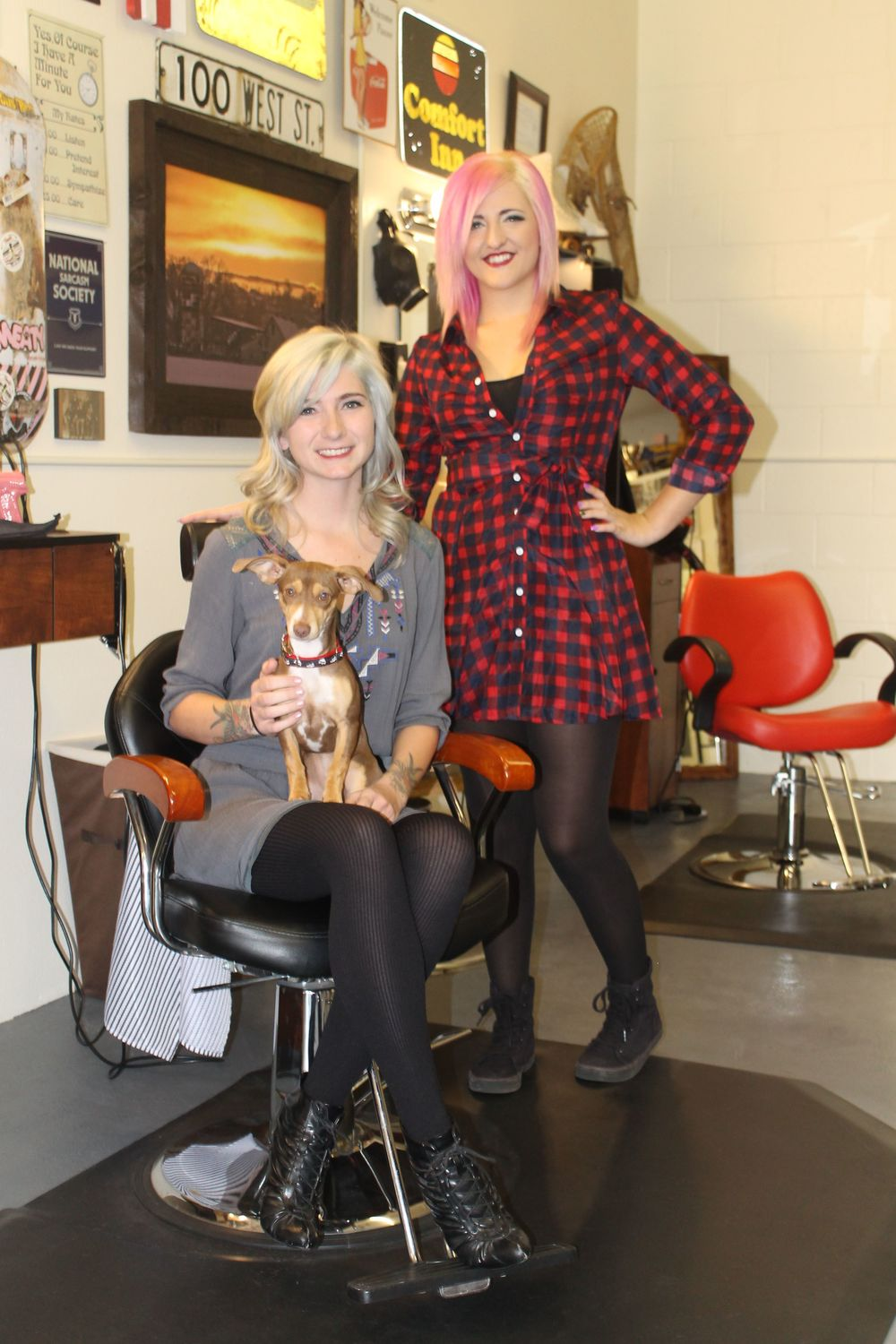 Pictured (left-right): Marci Aston, Classic Beauty & Barber owner and barber/stylist, and new stylist and color specialist, Breea Mahaffey Snelson, along with their sweet shop pup, Sweeney.