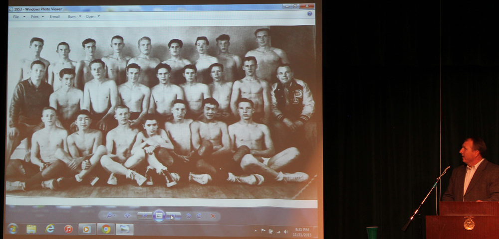 Pictured above: Gerald Loveless (third from right in middle row of team picture) and the 1953 Lions and Chris Loveless at the podium during The Second Annual Payson High School Wrestling Hall of Fame Banquet held Saturday, November 21, 2015