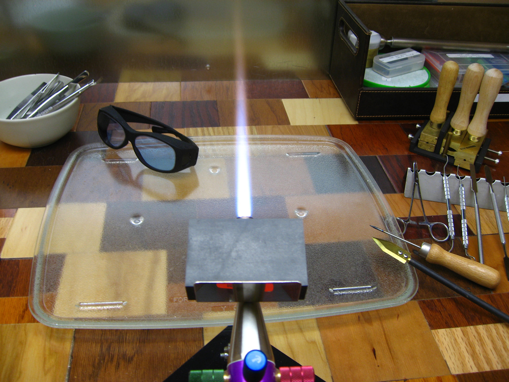 "Always wear protective didymium glasses. My pair is pictured to the left of the flame. It's of the ""fit over glasses"" variety. Note the purple/blue tint to the lenses. These safety glasses protect your eyes from bright yellow sodium flare and UV light."