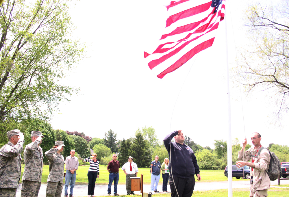 Joe Looman and Patrick Foote raise the flag while Lexington Employees Staff Sergeant Gary Davis, US Air Force Reserve; Senior Airman Quentin Hallenbeck, US Air Force Reserve; and Airman 1st Class Samantha Gifford, New York Air National Guard look on.