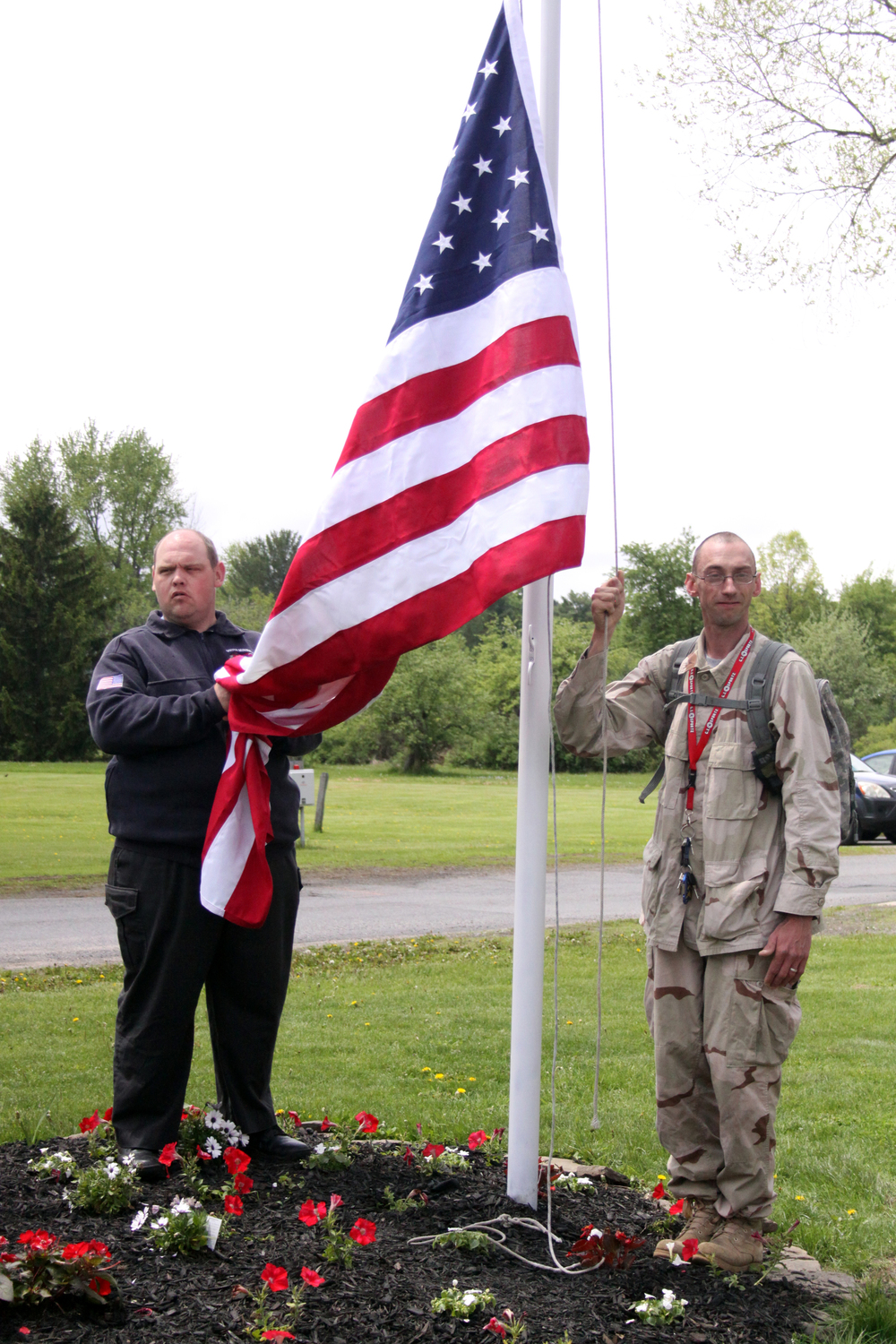 Joe Looman and Patrick Foote prepare to raise the flag.