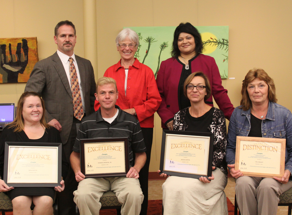 Back row: Lexington Deputy Executive Director Dan Richardson, Board President Judy Schelle and Executive Director Shaloni Winston pose with four of our Employees of the Year: Mina Denton, George Spencer, Brenda Dwyer and Val Bradt.