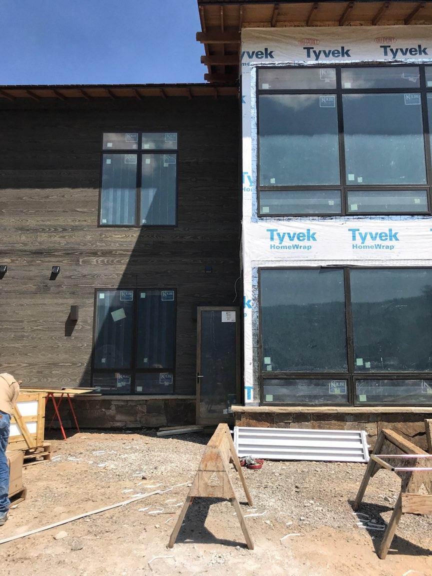 Big Sky custom home exterior view of windows and siding.jpg