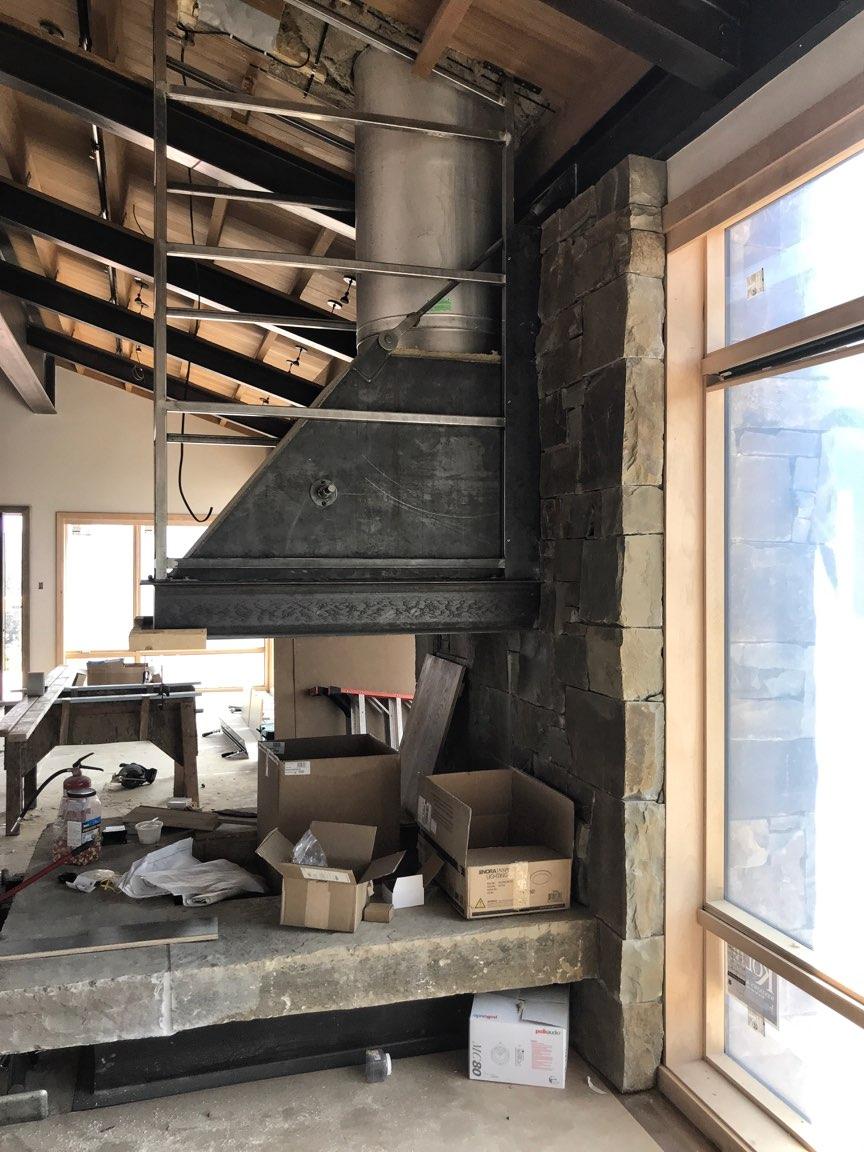 Big Sky custom home stone fireplace design in process.jpg