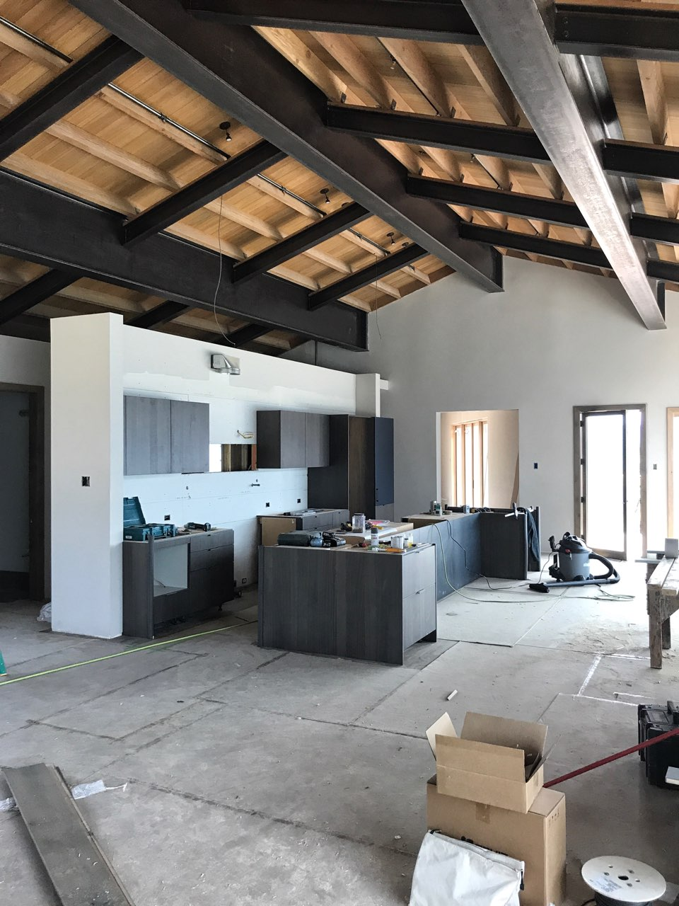 Big Sky Montana home custom interior ceiling with exposed beams and the kitchen in progress.jpg