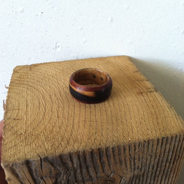 Finally made myself a ring. Brazilian cherry, stripped ebony, Olivewood burl around the inside and 3 dots of turquoise inlays for my daughters and one dot of Ore inlay for my son.