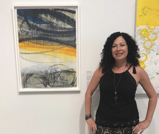 "Krieger with her painting ""Rocks and Rays 13"""