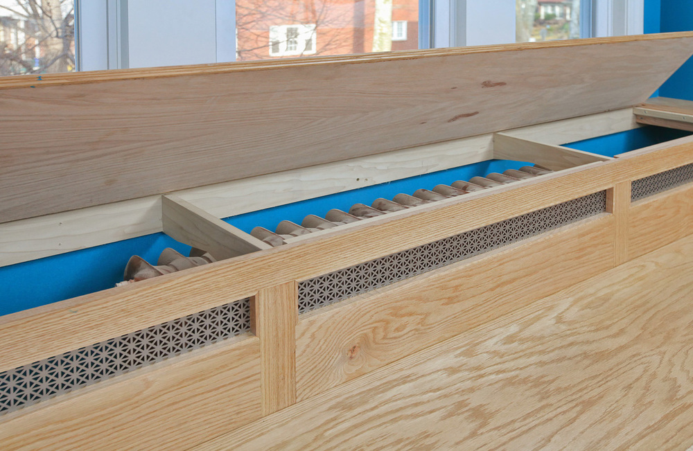 The piano-hinged top allows for service to the hidden radiator
