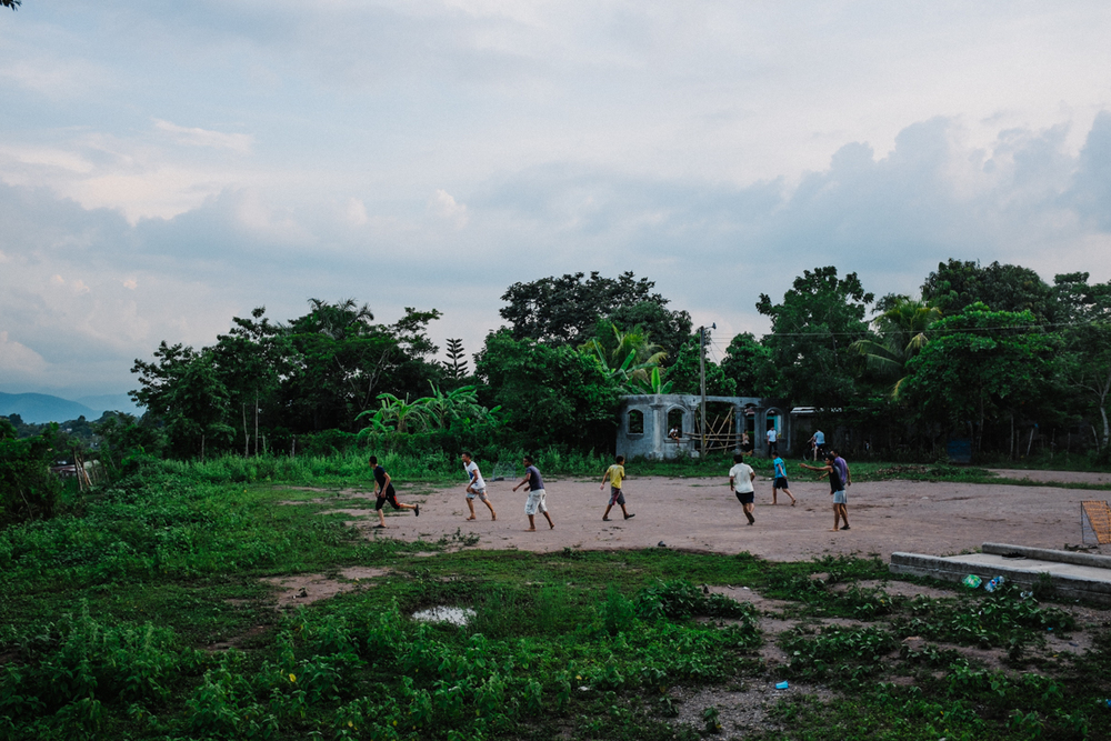 A Local park in Cofradia,Honduras.  An official was fishing for votes during an upcoming election so he put a 40 ft strip of sidewalk down near this soccer field, promising more infrastructure in the city. Immediately following his nomination, construction was stopped. apparently no one here was surprised.