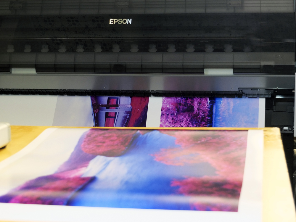 Tim Flower's print for In a different light coming off of the printer at The Print Room (printroom.co)