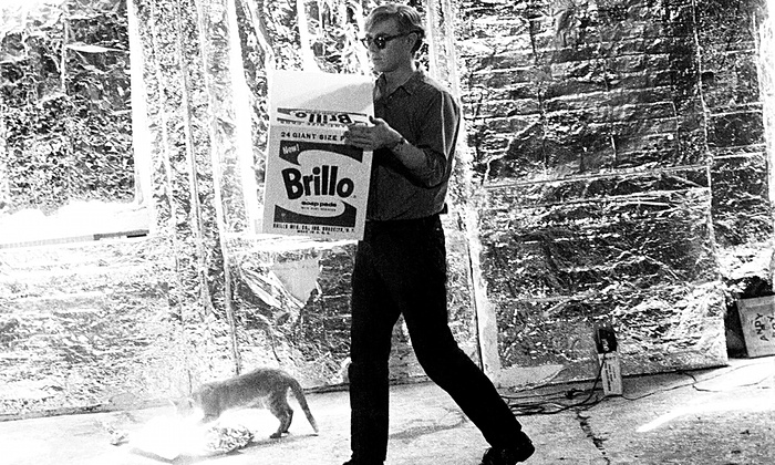 Andy Warhol with Billy Name's cat at the Factory (c) Billy Name 1964 via  the Guardian