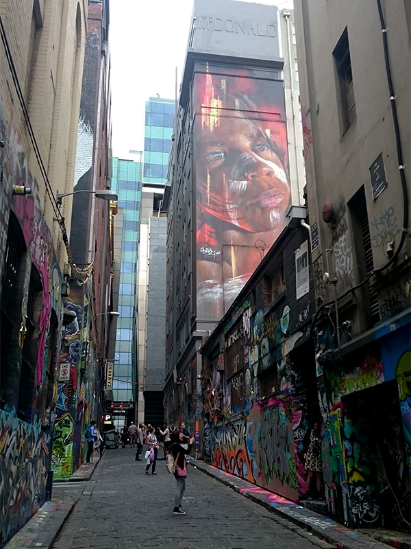 Hoisier Lane is iconic for its street art which blends into a giant wall of color, trickling down to the uneven bluestone paving and wrapping to a connecting laneway. Photo by Sarah Oberklaid.