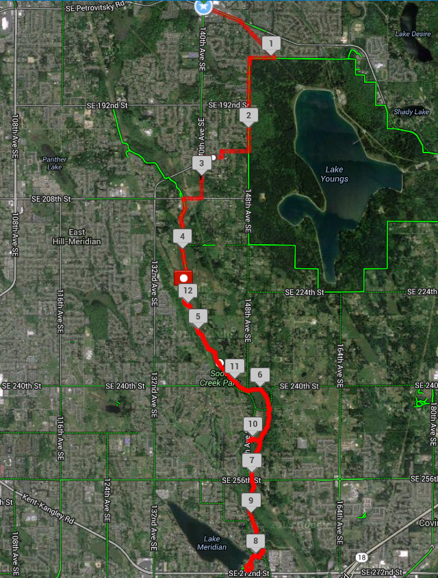 "1. Start at corner of Petrovitsky & 140th Ave SE    2. Head East on Petrovitsky & turn right onto Pipeline trail that runs behind Kindercare   3. Take until Lake Youngs Trail & make a right onto trail (head west)  4. Run to trail entrance at SE 183rd St (becomes 148th Ave SE) & make a left onto trail or run down 148th Ave SE (run opposing traffic)  5. Run down 148th Ave SE to SE 200th Street & make a right onto SE 200th Street  (Water Stop #1 @2.2 miles). Run opposing traffic  6. Take SE 200th St west to 143rd Pl SE & make a left onto 143rd Pl SE (@2.5mi at this intersection)  7. Take 143rd Pl SE to SE 201st and make a right onto SE 201st St (@2.57mi)  8. SE 201st become 140th Ave SE; stay on 140th Ave SE  9. Take 140th Ave SE to SE 208th St and make a right onto SE 208th St (run opposing traffic - @3.22mi)  10. Stay on SE 208th St & run to Gary Grant Soos Creek Park (bathrooms available/ WATER STOP # 2 @ 3.41mi ). WATER STOP DRIVER: Take 132nd to 208th & make a left onto 208th & park at Gary Grant.  11. To get on Soos Creek Trail make a left onto the trail from SE 208th St  12. Take Soos Creek Trail to SE 224th St & make a left onto SE 224th St. Run opposing traffic (@4.45 mi)  13. Re-enter trail on the left at mile 4.53  14.  Water Stop #3  at 148th Ave SE & Soos Creek Trail (closest intersection is SE 240th St & 148th Ave SE) Water stop at mile 5.87  15. Around Mile 6.6 keep left on the trail at the ""Y""  16. Around Mile 6.62 keep left again  17. At Mile 7 Susan & Mike will change running/water stop position ( possible water stop if needed ). Closest intersection is 148th Ave SE & SE 256th St. Left onto SE 256th St & meet at trail/SE 256th St Intersection.  18. Stay on trail until it ends at 152nd Way SE & SE 270th St. This is Mile 8 & Katey ends her run. Her car should be parked at Lake Meridian Park across the street for a  possible water stop  (#4).  19. Keep on concrete path at Lake Meridian Park & head south following the path. The path will make a big circle at the end. Follow the path around the circle & head back the way you came. (Playground should be to the right as you are coming up to the circle).  20. Go back to Soos Creek Trail & head back the way you came.  21. Around Mile 9.8 keep to the left of the trail & head towards Water Stop #4.  Water stop #5 is at Mile 10 . WATER STOPPER: Intersection of SE 249th St & 148th Ave SE is where this stop is.  22. Go back the way you came and stay left on the trail.  23. Mile 12.14 is the end of the run. Katey & Susan will be there to drive runners back to the start. Run ends at the intersection of SE 224th St & Soos Creek Trail. TO GET THERE BY CAR: Come from 148th Ave SE & make a left onto SE 224th St & meet runners along side road where the road intersects with the trail."