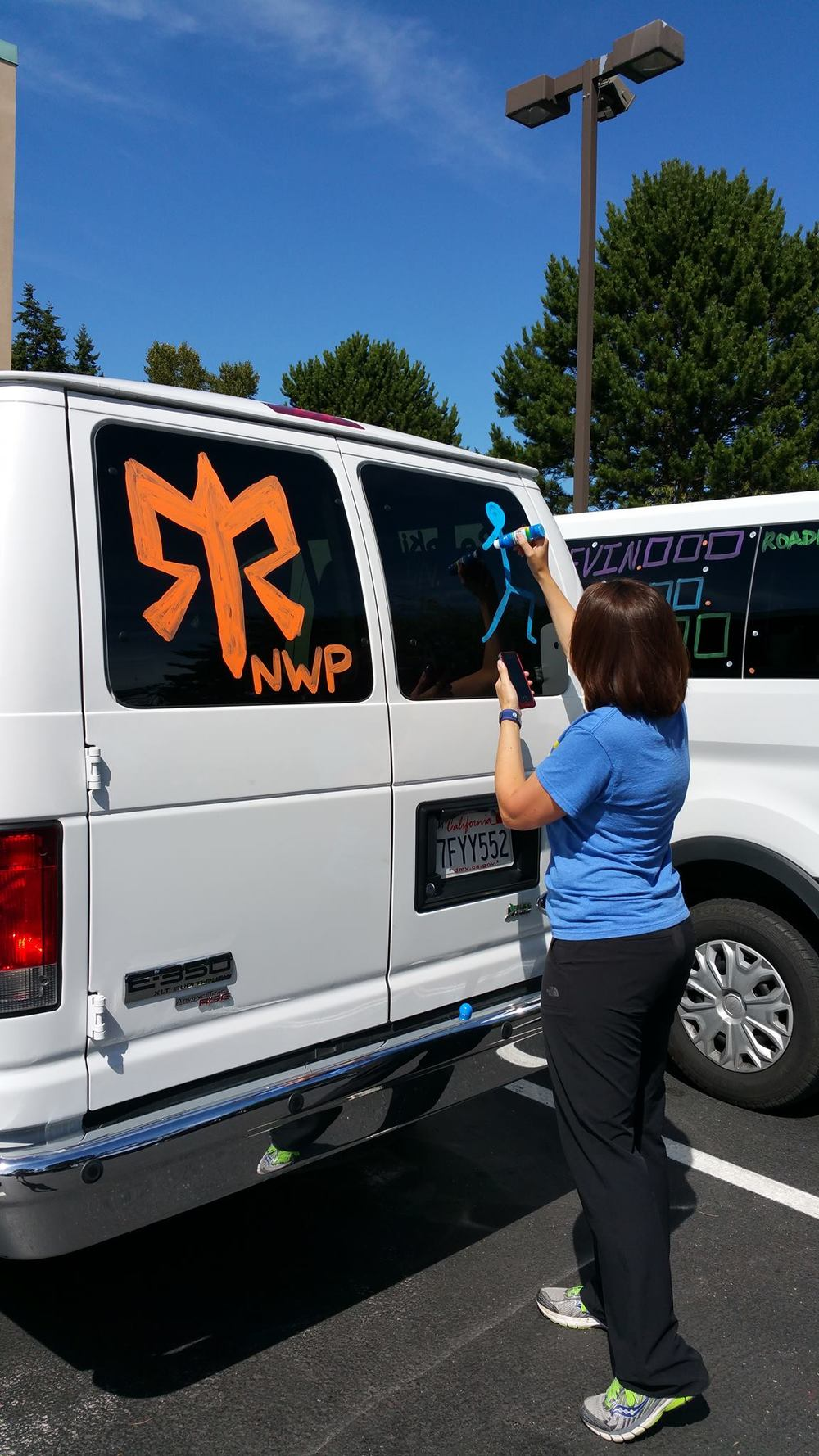 Erin helping decorate van 1.jpg