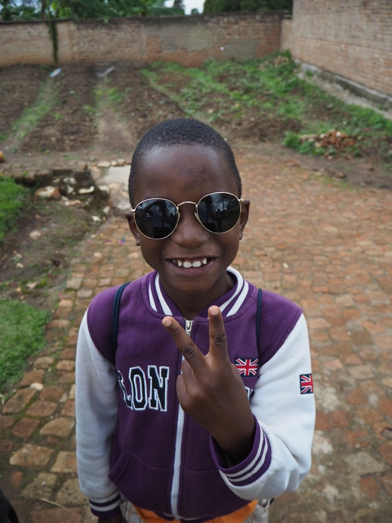 Little Claude stole my heart. We went on a walk around the local area and he insisted on carrying my bag the whole way and wearing my sunglasses, they really suited him! There was a big group of us but I spent most of the walk with him - he's a very well spoken boy, he really understands English and enunciates everything. It's harder for him to read and write unfortunately so I spent some quality time with him practicing which he found difficult - then I realised he's extremely talented at drawing and had more of a creative brain than academic.  The following week I found some notepads with colouring pencils and 5 hours later we had 10 drawings between us and only 2 of which were mine!  Little Claude came from a very hostile environment, he ended up with a family who didn't want him and turned up beaten, bruised and full of scars. He is now the happiest little boy with a dream of being a scientist.