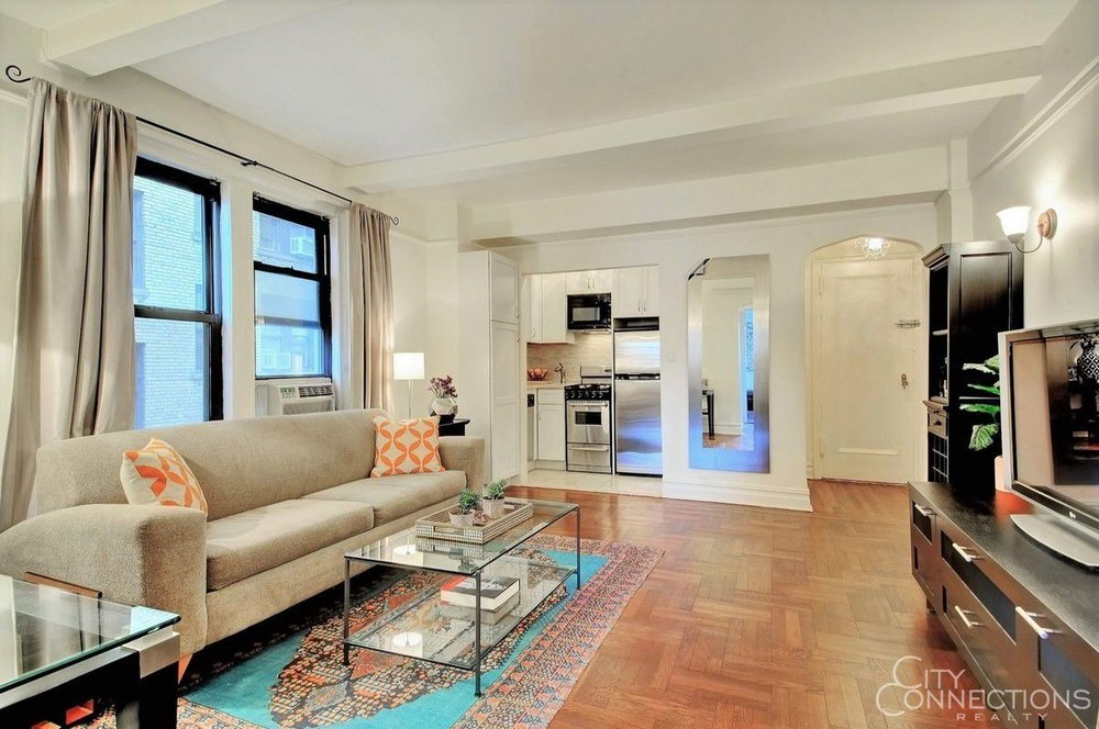 49 W 72 Street #9B - Fabulous One Bed on W 72nd/ Central Park now just $660k. Already the best value for this price in prime UWS but all offers are welcome! The Apartment: Approximately 630sf tranquil renovated cornerr one bedroom with tons of charm. From the 9th floor, the king-sized bedroom provides panoramic northern views that allow for wonderful natural light and picturesque sights of townhouses, gardens, iconic buildings, and even a slice of Central Park! Eastern exposures are offered in the living room, kitchen and bath. Along with a well laid-out floorplan, the home retains it's pre-war character with arched doorways, beamed-ceilings, molding and original hard wood floors that were beautifully re-finished. Combined with the gut-renovated kitchen, updated bath, upgraded storage and lighting…there is so much to love! The Building: Well-established co-op featuring a part-time doorman, handyman, and live-in super, with laundry and storage in the basement. Shareholders are able to sublet indefinitely after 3 years and pied-a-terres are welcome! The Location: Just steps from Central Park, minutes to Lincoln Center, down the block from the B, C, 1, 2, 3 trains, you can't beat this location in the heart of all the fabulous eating, shopping and culture that this dynamic neighborhood offers.Price: $620,000 Maint/CC: $1,351.91Financing Allowed: 80%Tax Deductibility: 61%