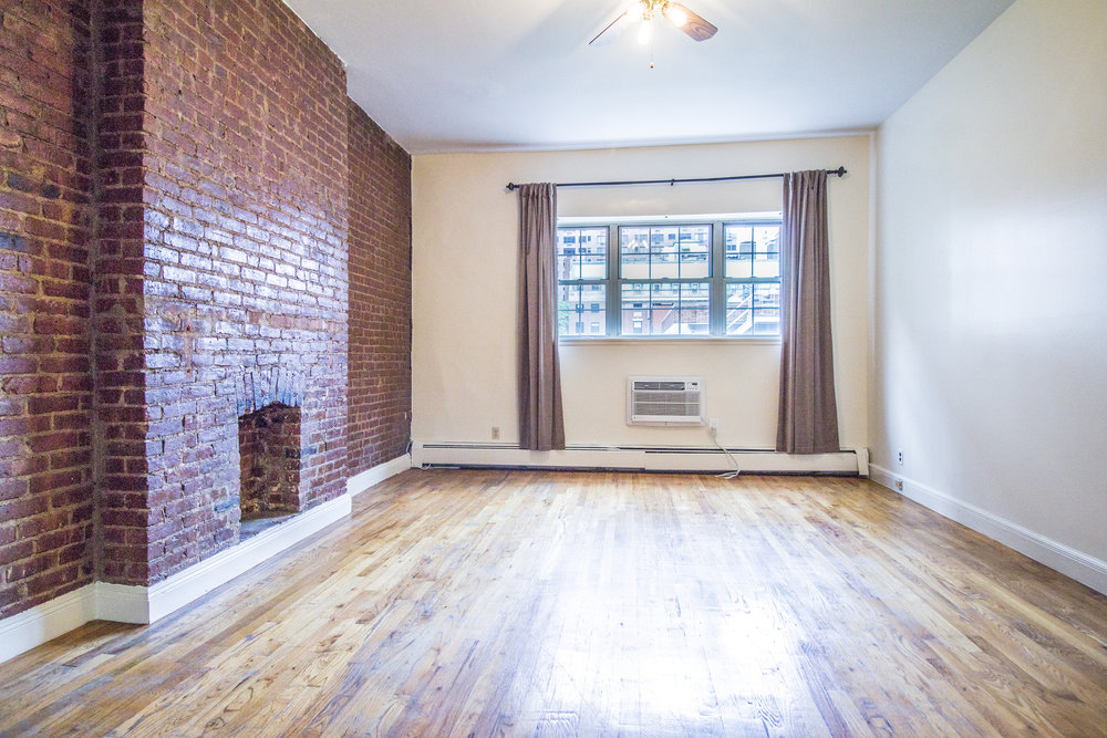 218 E 70 Street #4B - Large studio in great UES location. Apartment features very high ceilings, exposed brick wall, decorative fireplace, separate eat-in kitchen and hardwood floors.The building is located on 70th street between 2nd and 3rd Avenues, has an elevator and laundry the on premises.Rent: $2,095 /monthTerms: 12 - 12 MonthsAvailable: Immediate