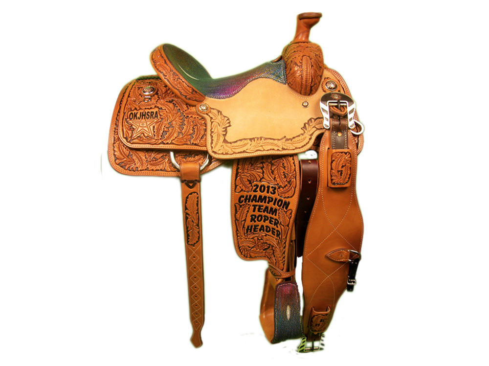 Saddle Details:  7/8 Small DJ Oak with Brown Dyed Background. Small DJ Oak with Dyed Background Border in Seats. TS 400 Patterns. Rust Conchos. Rust Flank Buckles. Rainbow Stingray Seat. Matching Stingray Stirrups.