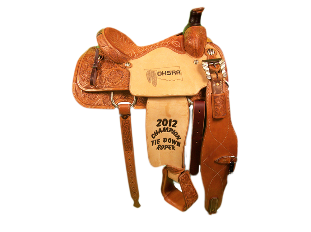 Saddle Details:  3/4 Wildflower. TS 100 Patterns. Tooled Stirrups. Latigo Horn Wrap. Rust Conchos and Rust Flank Buckles