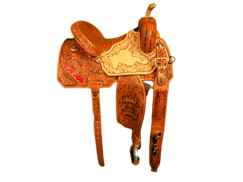 Saddle Details:  7/8 Wilke Floral and Brown Dyed Background with Wilke Floral Border and Dyed Background in Seats.Angle Cut Patterns;Rawhide Braided Horn.Bicycle Inlay Vintage Cognac Caiman Seat.Rust Conchos.