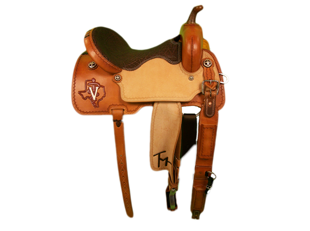 Saddle Details:  Smooth Out Skirts, Front and Binder.Rough Out Seats and Fenders.Full Barbed Wire Border.Traditional Pattern with Leg Cut.Rawhide Braided Horn.Bark Elephant Seat.Rust Conchos.