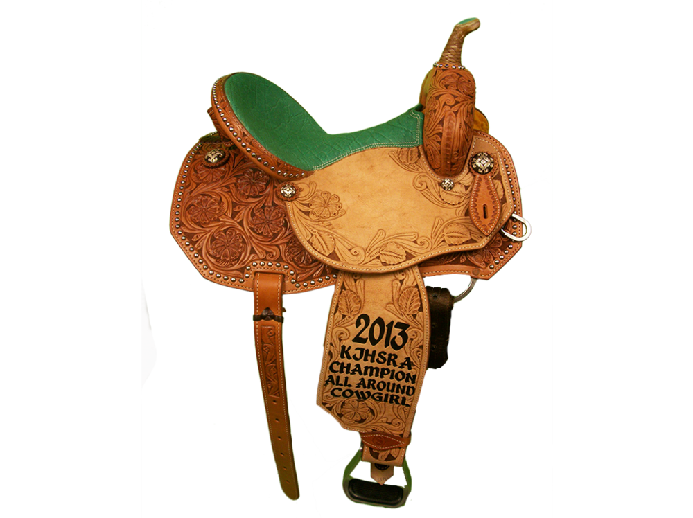 Saddle Details: Angle Cut Patterns.3/4 Daisy with Brown Dyed Background.Daisy Border in Seats & Fenders with Brown Dyed Background.Spots: Skirt, Binder, & Around Horn.Rawhide Braided Horn.Rust Conchos.Turquoise Elephant Print Seat.
