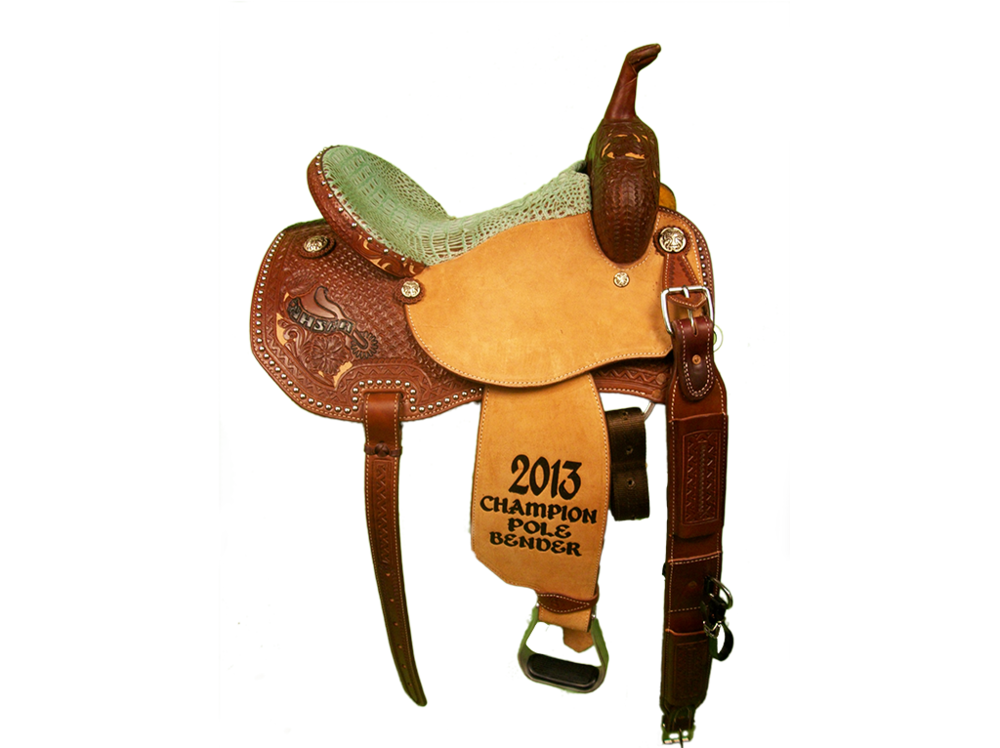 Saddle Details: Angle Cut Patterns.3/4 Combination Tooled - Wyoming Floral & Spider with a Tan Dyed Background.Dark Oil.3/4 V Border.Spots: Skirt.Mint Chocolate Chip Gator Print Seat.Rust Conchos.